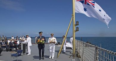 Chief of Defence Force Air Chief Marshal Mark Binskin and Chief of Navy Vice Admiral Tim Barrett carry wreaths to cast from the flight deck of HMAS Choules during the commemoration of the Battle of the Coral Sea. Photo by Able Seaman Richard Cordell.