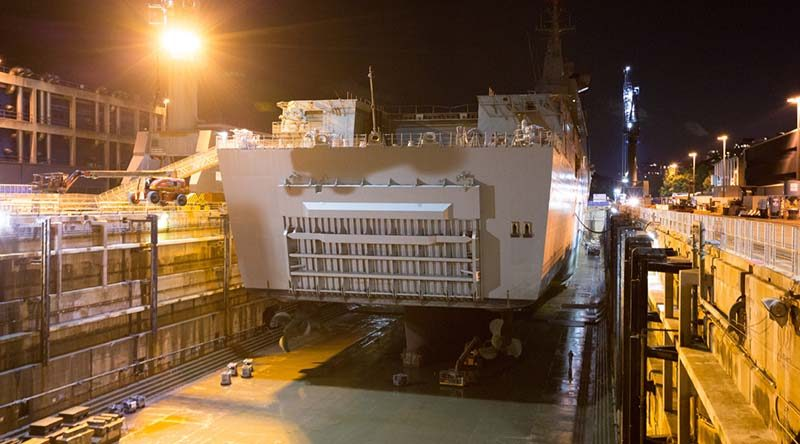 HMAS Adelaide rests on blocks within Captain Cook Graving Dock at Fleet Base East, Sydney, after entering dry dock for maintenance. Photo by Leading Seaman Peter Thompson.