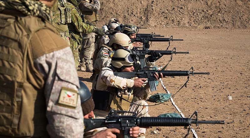 Australian and New Zealand Army trainers from Task Group Taji 4 conduct marksmanship training with an Iraqi Army training audience at Al Taqqadum, Iraq. ADF photo.