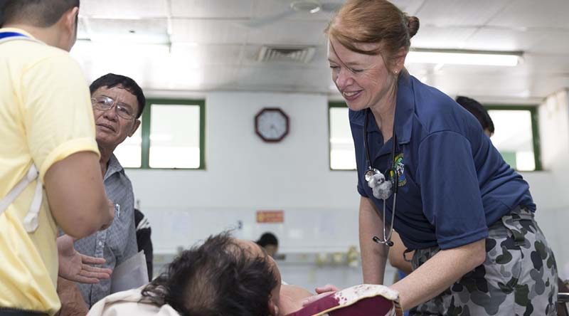 Royal Australian Navy Nursing Officer Lieutenant Commander Alison Zilko tends to a Vietnamese patient at the Emergency Reception at Da Nang General Hospital during Exercise Pacific Partnership 2017. Photo by Sergeant Ray Vance.