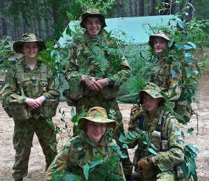 Cadets from 617 and 619 Squadrons practice camouflage and concealment – (back): LCDT Catriona Mathison, CCPL Nathan Richmond and LCDT Justin Blake; (front): LCDT Stephen Davis and CCPL Alexander Barrott-Walsh.
