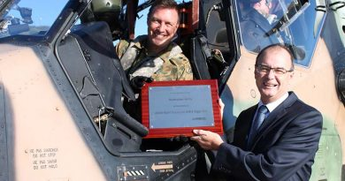 Lieutenant Colonel David Lynch, Commanding Officer School of Army Aviation, accepts a plaque to commemorate A38-001's world-first milestone on exceeding 2000 flight hours, from Managing Director Airbus Group Australia Pacific Tony Fraser. Airbus photo.