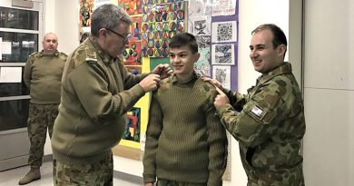 The Commanding Officer of 619 Squadron, Flying Officer (AAFC) Simon Blair presents rank slides to Cadet Adomas Neocleous as he is reclassified as a Leading Cadet. The CO is assisted by LAC(AAFC) Steve Stagbouer. Image supplied by No 619 Squadron