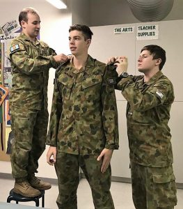 Commanding Officer 619 Squadron, Flying Officer (AAFC) Simon Blair promotes Cadet Corporal Nathan Richmond to Cadet Sergeant, assisted by Cadet Under Officer Lachlan Renfrey. Image supplied by No 619 Squadron