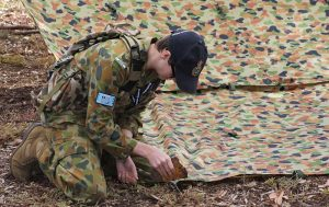 A Cadet from No 613 Squadron (Edinburgh) prepares an individual shelter as part of the Wing Fieldcraft Competition. Image by Pilot Officer (AAFC) Paul Rosenzweig