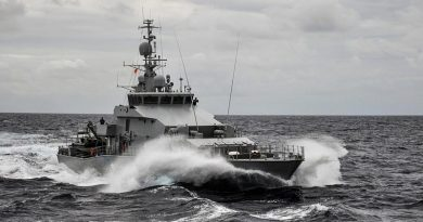 HMNZS Hawea takes up station alongside HMAS Wollongong as the two ships practice Officer of the Watch manoeuvres off Fiji. Photo by Able Seaman Neil James.