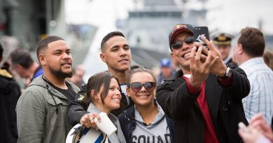 Family members pose for a selfie on the wharf at Fleet Base East before HMAS Newcastle departs for Operation Manitou. Photo by Able Seaman Bonny Gassner.