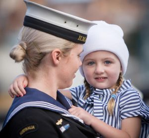 Leading Seaman Leticia Hosking holds her daughter before embarking in HMAS Newcastle for departure to the Middle East. Photo by Able Seaman Bonny Gassner.