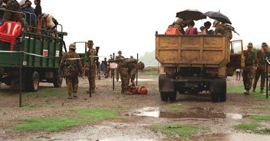 Soldiers operate a vehicle check point on a road in East Timor, 1999. Photo by Corporal Brian Hartigan.