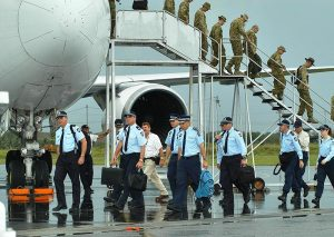 The first contingent of Australian Federal police arrive in Honiara.