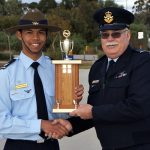 Cadet Sergeant Michael Santos receives the Wing Aircraft Recognition Competition trophy from OC 6 Wing, Wing Commander (AAFC) Peter Gill.