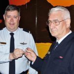 PLTOFF (AAFC) Dennis Medlow receives his Individual Proficiency Badge from the CO of 604 Squadron, FLGOFF (AAFC) John Bennett. Image by Pilot Officer (AAFC) Paul Rosenzweig