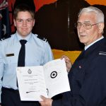 LCDT Lachlan Jenkins receives his Gold Rifle badge from the CO 604 Squadron, FLGOFF (AAFC) John Bennett.