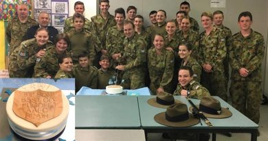 Outgoing Commanding Officer of No 619 Squadron FLGOFF(AAFC) Simon Blair cuts his farewell cake with members of the squadron. Image supplied by 610 SQN