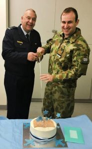 FLGOFF(AAFC) Simon Blair cuts his farewell cake with incoming Temporary Commanding Officer FLTLT(AAFC) James Roncoli. Image supplied by 619 Squadron AAFC