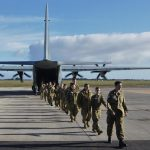6 Wing Australian Air Force Cadets disembark a 37 Squadron C-130J Hercules after an air-experience flight.
