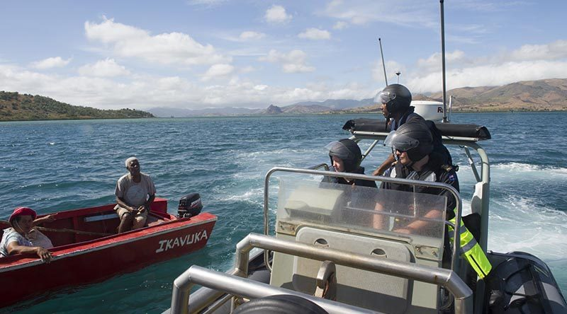 Fijian Fisheries Officer Waisea Aka speaks to a local fisherman during a HMNZS Hawea-assisted fisheries and customs patrol in Fiji. NZDF photo.
