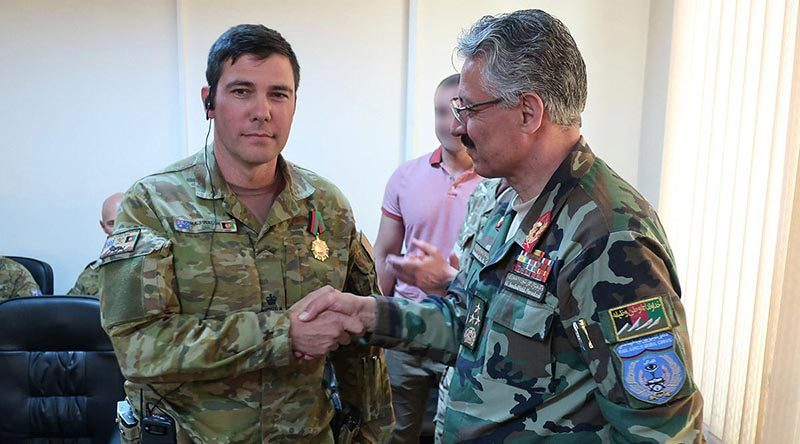 Australian Army Major Conrad Walsh is awarded the Afghan Ministry of Interior Medal of Honour.