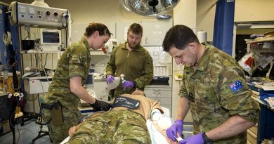 Task Group Afghanistan medics Flight Lieutenant Tessa O'Brien, Leading Seaman Peter Gough and Lieutenant Commander Gavin Milkins treat a simulated patient at the Role 2 Enhanced NATO Medical Treatment Facility at Hamid Karzai International Airport, Kabul, Afghanistan. Photo by Sergeant Ricky Fuller.