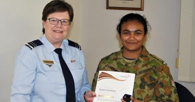 Leading Cadet Tharane Thamodarar of 604 Squadron receives a Bronze Level Badge and certificate from FLTLT(AAFC) Rae Nicholas, the 6 Wing Duke of Edinburgh International Award Coordinator. Image by Pilot Officer (AAFC) Paul Rosenzweig