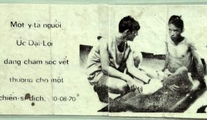 An Australian nurse in charge of a life for a change –with our maggot-leg mate on a propaganda leaflet.