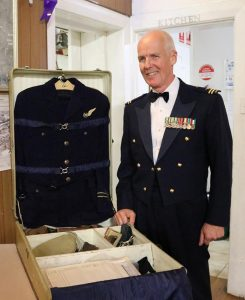 Guest of Honour Flight Lieutenant Guy Bowering (ret'd) with the unique 'travelling wardrobe' of Flight Lieutenant William Edge. Images supplied by 617 Squadron.