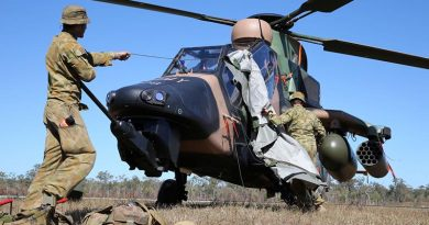 Craftsman Hayden Bermicham (left) and Craftsman Rhys Johannessen take the cover off a Tiger helicopter in preparation for pre-flight servicing at Shoalwater Bay Training Area during Exercise Talisman Saber 2013. Photo by Corporal Max Bree.