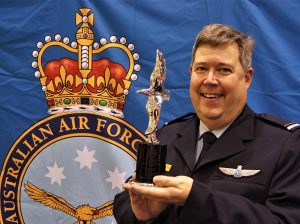 Pilot Officer (AAFC) Dennis Medlow, with his Hoinville Award trophy. Image by Flying Officer (AAFC) Paul Rosenzweig.
