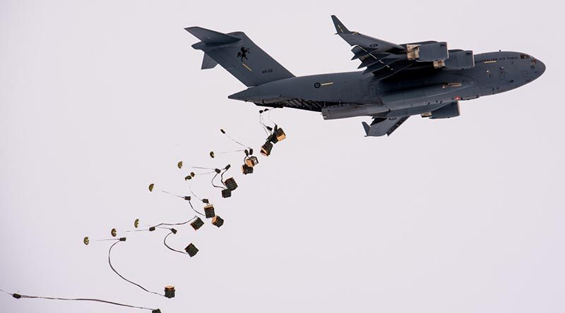 A RAAF C-17A airdrops supplies at Davis research station in Antarctica. Photo by Barry Becker, Australian Antarctic Division.