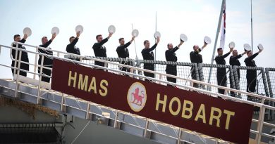 HMAS Hobart's ship's company 'cheer ship' during her commissioning at Garden Island, Sydney. Photo by Able Seaman Bonny Gassner.