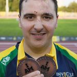 Royal Australian Air Force Pilot Officer Nathan Parker shows off two bronze medals he won during the first full day of competition at the 2017 Invictus Games in Toronto. Photo by Corporal Mark Doran.