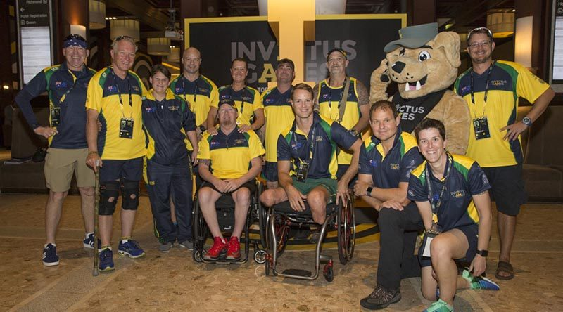 Some of the Australian Invictus Games athletes with the Invictus Games mascot at the Athletes Village, Toronto, Canada.