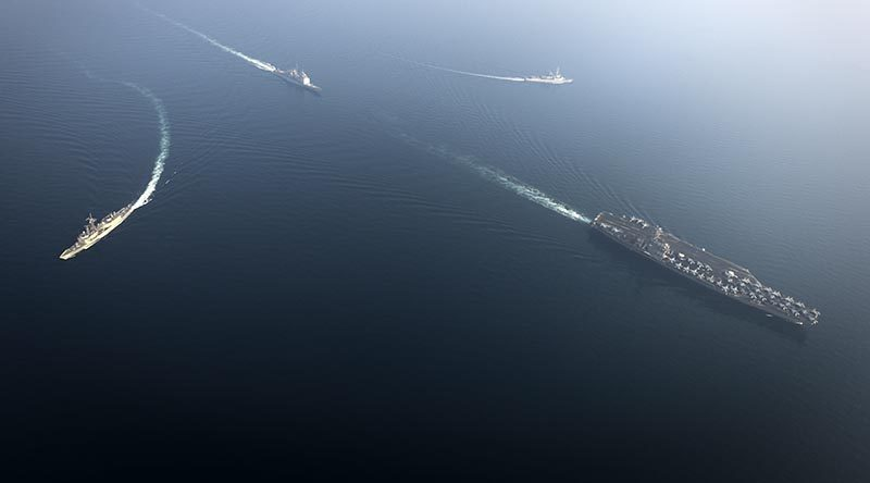 HMAS Newcastle (left) breaks formation with US aircraft carrier USS Nimitz, USS Princeton and France's FS Jean Bart. US Navy photo by Mass Communication Specialist Seaman Emily Johnston.