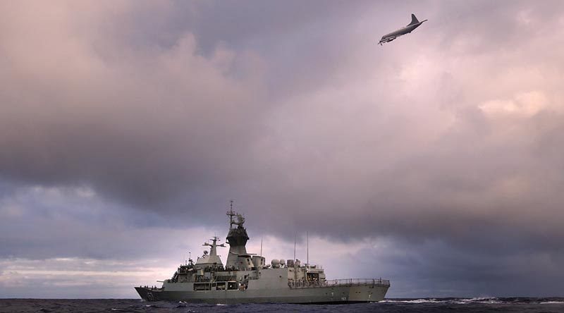 HMAS Perth is overflown by a RNZAF P-3K Orion. Photo by Able Seaman Nicolas Gonzalez.