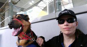 Melanie Scott and trainee Service Dog Paddington at the train station.
