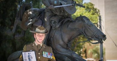 Australian Army Sergeant Janine Fabre visits the Park of the Australian Soldier in Be'er-Sheva ahead of the commemoration of the centenary of the Battle of Beersheba in Israel, with a photo of her great uncle who participated in the famous charge. Photo by Corporal Nunu Campos.