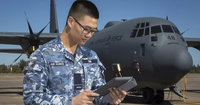 Flying Officer Josh Suh, Logistics Officer with Headquarters Air Mobility Group - Capability Development Cell, connects to the Ka-Band SATCOM during a technology-demonstrator trial. Photo by Corporal David Gibbs.