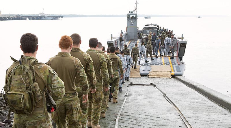 Australian soldiers and Malaysian Armed Forces personnel step aboard an LHD landing craft from HMAS Adelaide during a visit to Port Klang, Malaysia, for Indo Pacific Endeavour 2017.