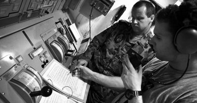 Mentoring below decks on HMAS Melbourne, Persian Gulf. Photo by Brian Hartigan, 2012.