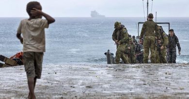 A local boy on Pentecost Island in Vanuatu greets sailors and soldiers from HMAS Choules during Operation Vanuatu Assist 2017. Photo by Able Seaman Jake Badaior.