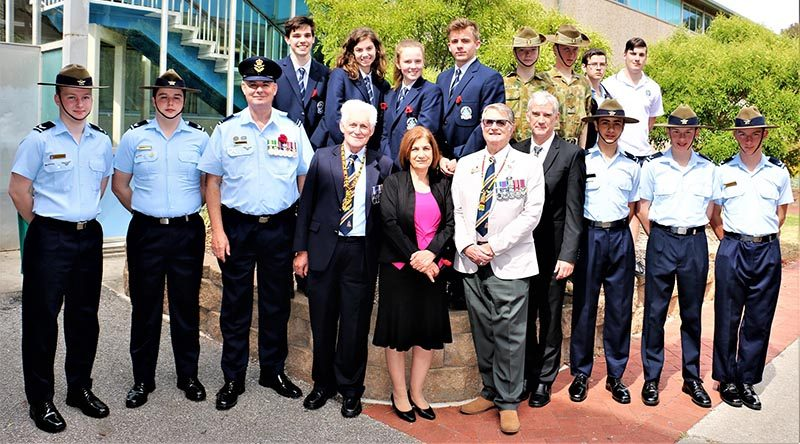 Modbury High School Remembrance Day ceremony participants (front row, from left): CCPL Joshua Watson (Guard Commander); CCPL Anthony Sanchez; FLGOFF (AAFC) Paul Rosenzweig; Don Cameron; Joanne Costa, Principal; Brian Selby; David Kschammer, Deputy Principal; LCDT Zain Carse; LCDT Mikale Durham; LCDT Byron Barnes-Williams. Image courtesy Modbury High School.
