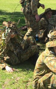 Cadets during a camouflage lesson during 609 Squadron's fieldcraft bivouac, Exercise 'Laika'. Photo supplied by No 609 Squadron AAFC.