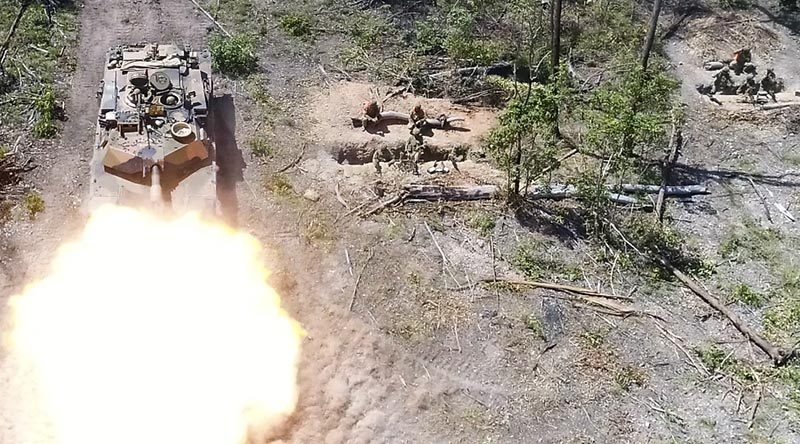 An M1A1 Abrams Main Battle Tank fires on Exercise Diamond Run 2017. Photo by Captain Anna-Lise Brink.