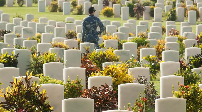 A RAAF member of the HMAS Adelaide crew walks through the headstones of Bomana Commonwealth War Cemetery, in Papua New Guinea, during Indo-Pacific Endeavour 2017. Photo by Private Roger Brennan.