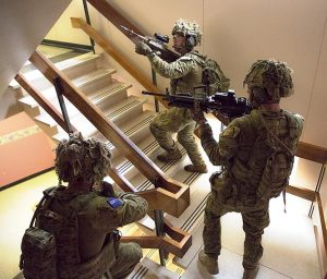 Soldiers conduct a multi-storey-building clearance as part of the 2017 Contested Urban Environment Strategic Challenge conducted in Adelaide South Australia. Photo by Corporal Craig Barrett.