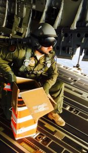 An un-named RAAF C-17 crew member prepares to drop a 'helibox' containing vital medical supplies. The boxes are designed to rotate enough to slow their decent. RAAF photo.