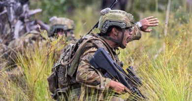 An Australian soldier from 8th/9th Battalion, Royal Australian Regiment, 'communicates effectively in a high-pressure tactical situation'. Photo by David Said.