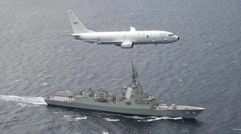 A RAAF P-8A Poseidon supports sea trials for NUSHIP (now HMAS) Hobart in the Gulf St Vincent off the coast of Adelaide. Photo by Corporal Craig Barrett.