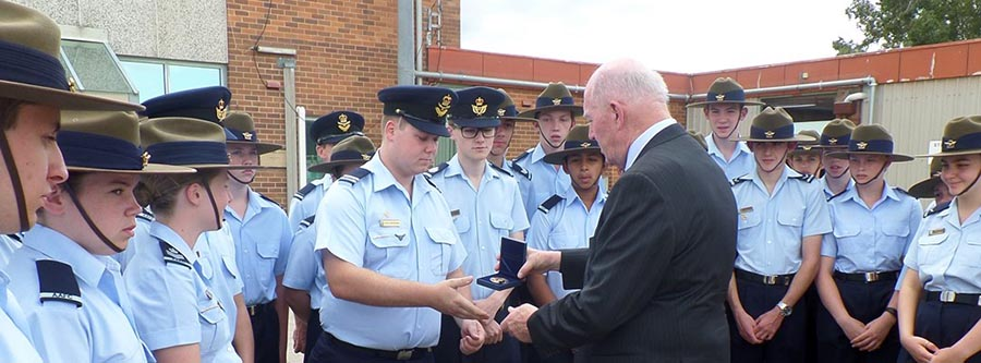 CUO Jordan Klompenhouwer receives a Governor General's Medallion from Sir Peter Cosgrove, on behalf of 336 Squadron AAFC.