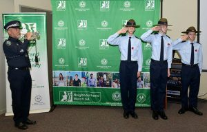 Cadets Ethan O'Connor, Joshua Duncan and Darcy Needle from No 605 (City of Onkaparinga) Squadron salute the Last Post.